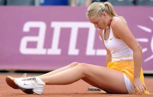 Maria Sharapova of Russia falls on the clay during her quarterfinal match against Ukraine's Alona Bondarenko during the WTA Warsaw Open tennis tournament