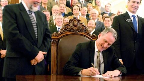 South Dakota governor Dennis Daugaard signing armed teacher bill