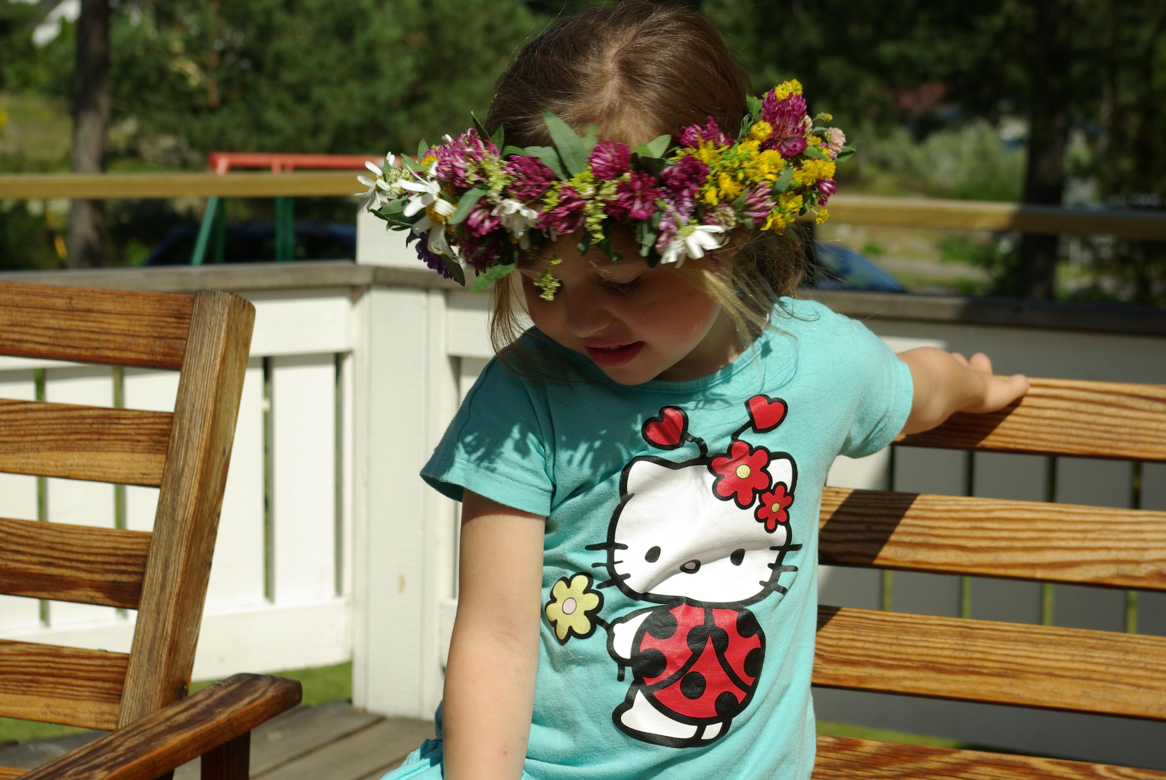 Alma med blomsterkrans